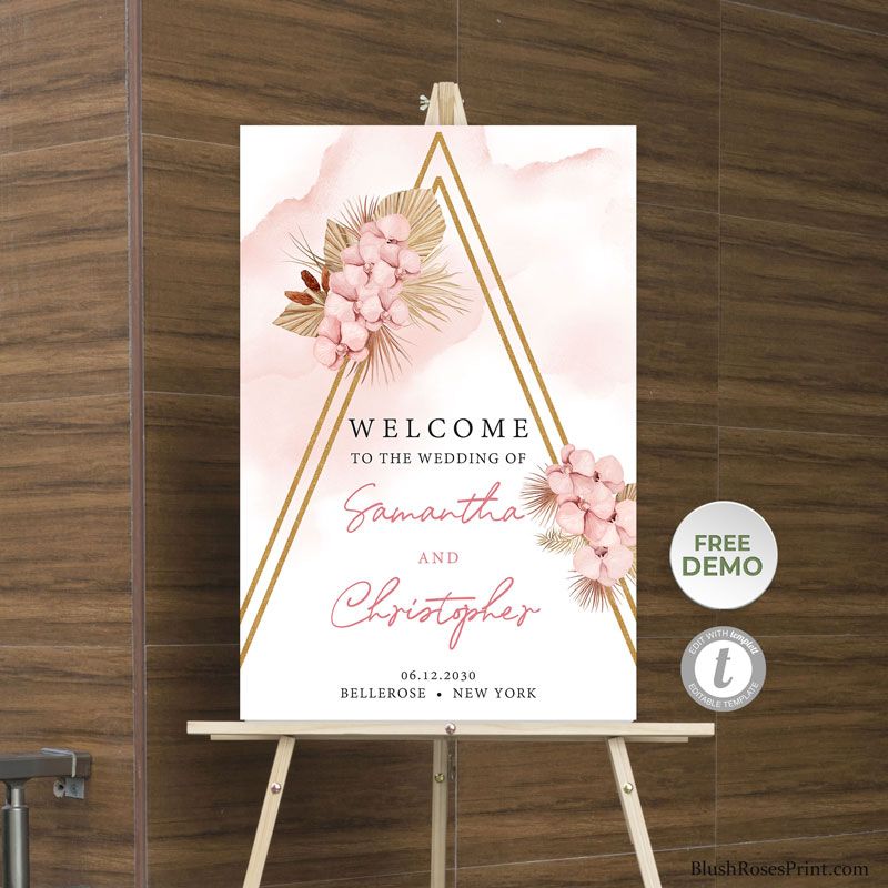 dusty pink flowers orchid and dried palm welcome sign